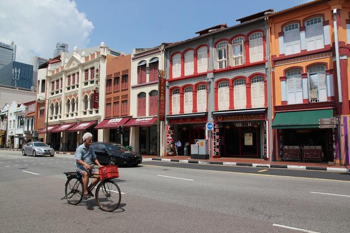 Man riding bicycle in Singapore Chinatown