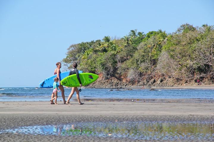 Surfers on Estero Beach, Santa Catalina, Panama