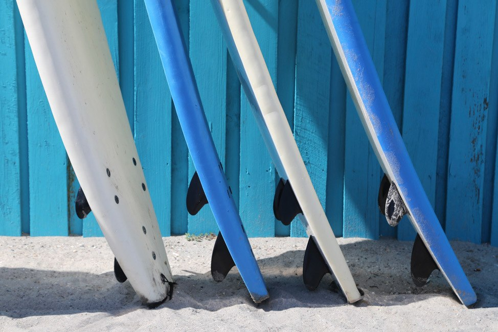 Surfers at Cocoa Beach Pier