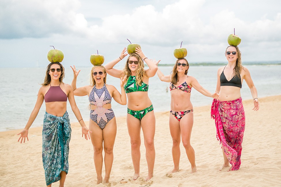 Girls with coconuts on their heads in Bali