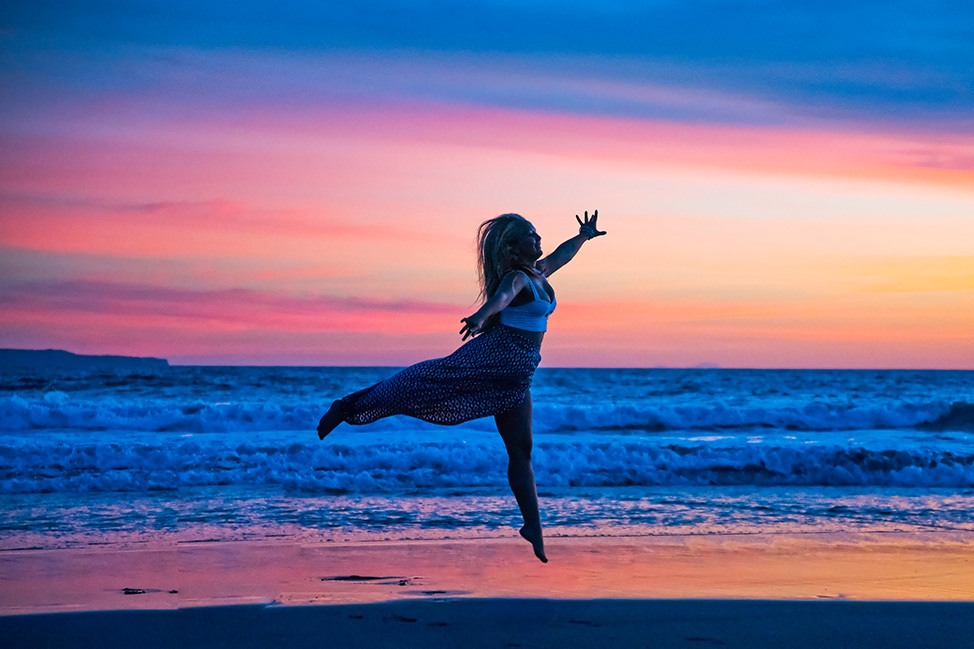 Leaping in front of a blue Bali sunset