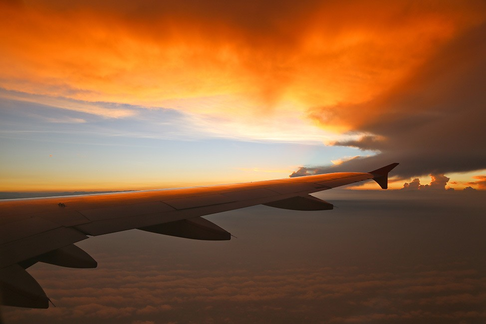 Sunset Over The Wing of a Plane