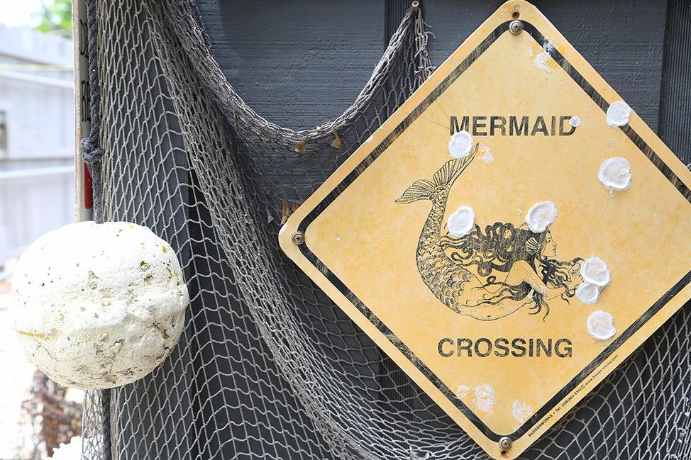 Mermaid crossing sign at Jules Undersea Lodge in Key Largo, Florida