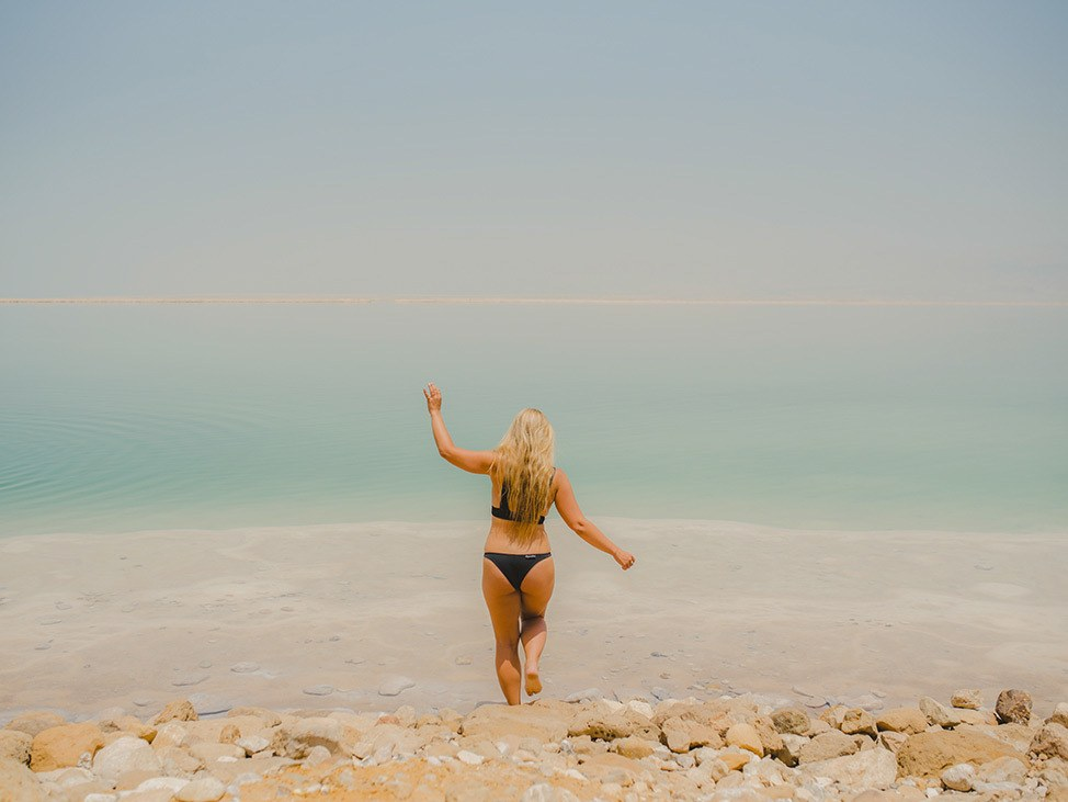 Young women walking into the Dead Sea, Israel