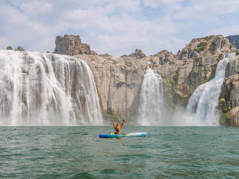 Wander Women Virtual Retreat kayaking near a waterfall in Idaho