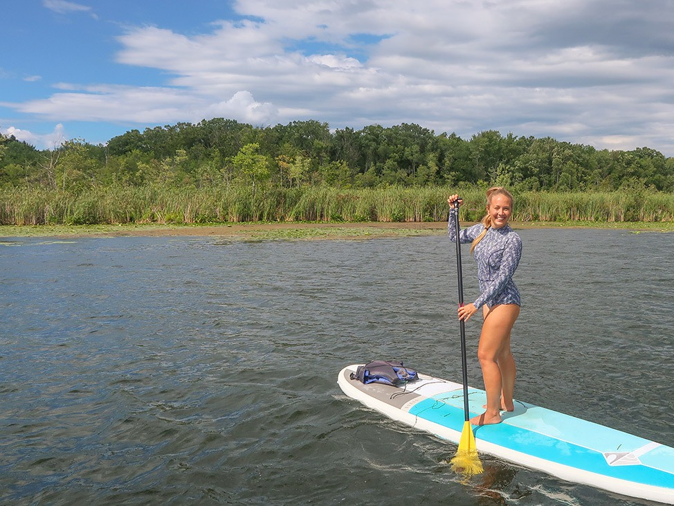 Wander Women Virtual Retreat stand up paddle boarding in Florida