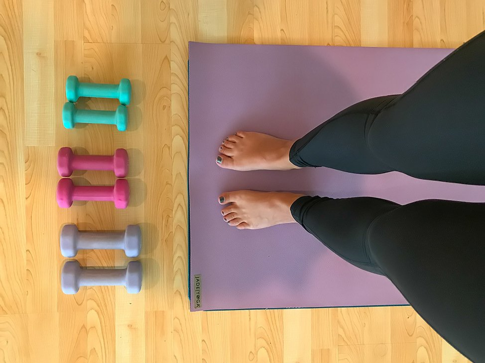 Wander Women Virtual Retreat doing yoga at home with weights