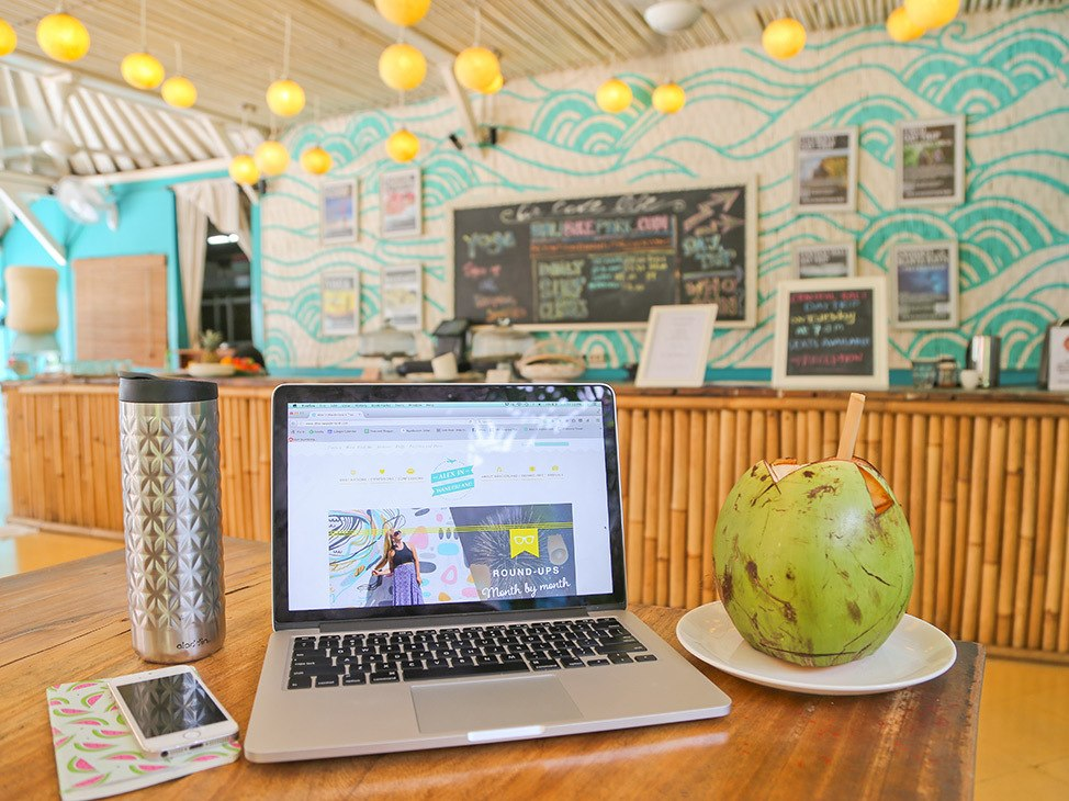 Wander Women Travel Workshop 2021 laptop in cafe with fresh coconut working remote