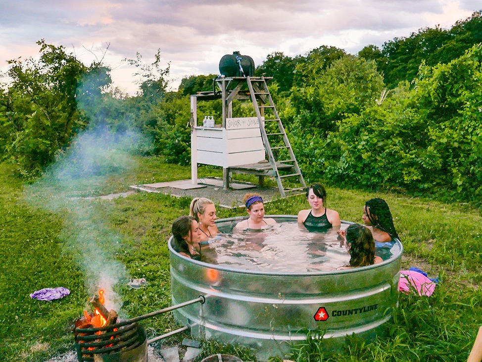 Wander Women Hudson Valley: hot tub in steel tank glamping in upstate New York